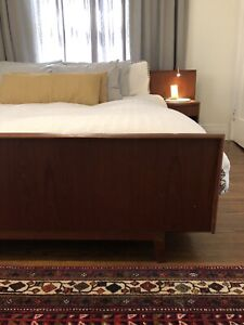 Beautiful king size teak bed with built in side tables.