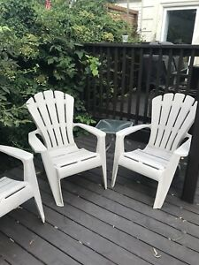 Plastic Adirondack chairs x 4 plus glass side table
