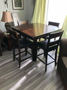 Table and four matching chairs and two extra similar chairs