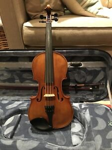 QVC intermediate 1/2 size violin outfit. Excellent sound.