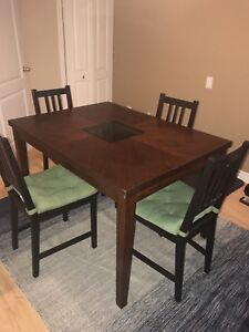 Wooden dining table with four wooden chair