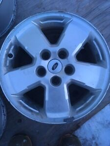 4  16 inch ford Escape rims in ok  shape with sensors