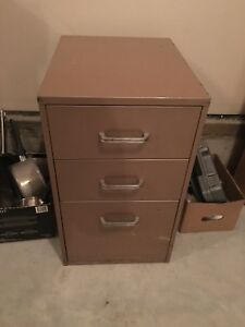 Small three drawer filing cabinet.
