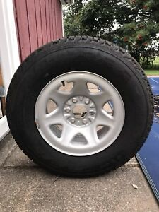 4 STUDDED FIRESTONE WINTER FORCE TIRES & RIMS