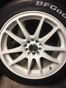 Set of 4 R-Spec Stag wheels with like new tires