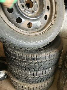Four Toyota Echo Tires with Rims