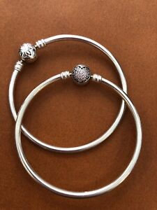 Size small PANDORA bangles. One silver. One pale pink heart