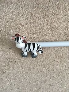 Curtain rod & zebra finial