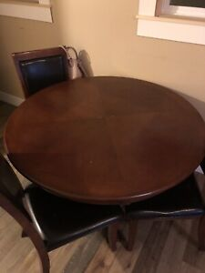 Well used table and 4 chairs