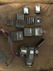 Canon EOS 70D with 3 lens, 1 speedlite and accessories