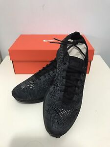 Unisex Nike Flyknit Racer Triple Black Midnight size US6.5 Cabramatta Fairfield Area Preview