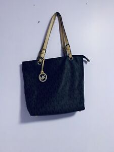 Gently used Mk tote bag little rip straps