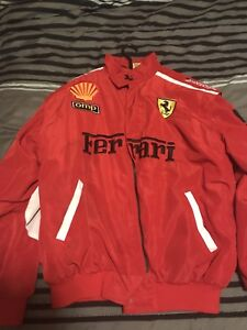 1996 official Ferrari Jacket signed by Mario Andretti