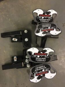 Torklift Talon camper tie downs.  Front and Rear