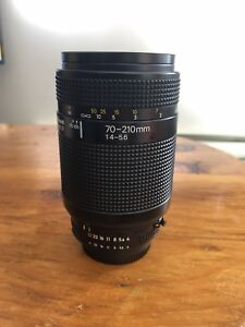 Nikon 70-210mm telephoto lens with UV filter, cap and hood
