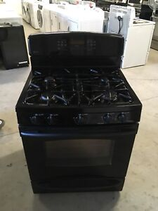 New condition GE black gas stove
