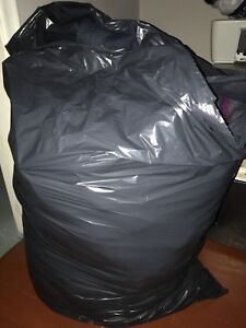 2 Giant Garbage Bags of women's clothing