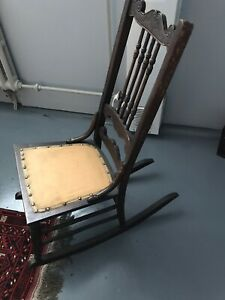 Antique wooden rocking chair with carvings