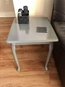 2 grey end tables with coffee table