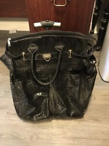 Black leather luggage or laptop purse wheel bag