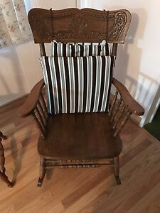 Antique rocking chair with cushion