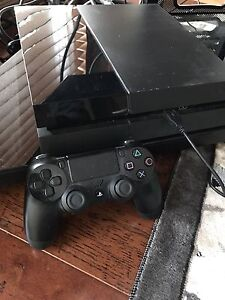PS4 console with controller and game
