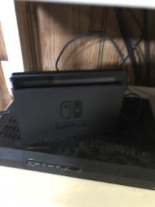 Nintendo Switch with games and controllers
