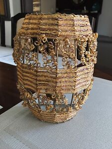 Wire framed candle holder with beadwork