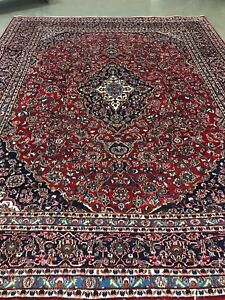 Large red Persian handmade rug