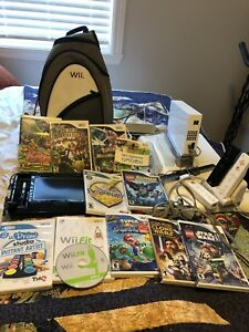 Wii with accessories , games