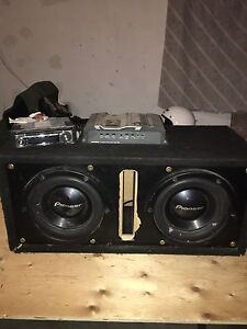 The whole car kit ( deck, amp, compassiter,  subwoofers in box)