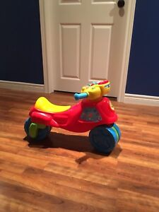 Motorcycle riding toy