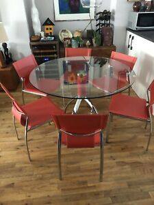 Round glass top dining room set with 6 red leather chrome chairs