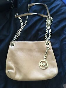 Authentic Michael Kors bag with adjustable strap!