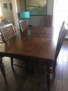 Dining table and 4 chairs 6 ft to 8ft with 2 leafs