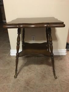 Parlour table   With brass claw feet