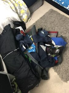 Couple garbage bags full of 7-8 clothing