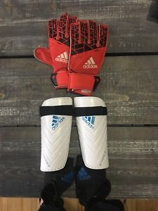 Boys Adidas shin pads, under armour cleats and keeper gloves