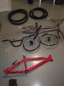 Multiple BMX parts: frames, forks, cranks, etc