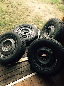 Quick sale!! 15 inch winter tires with rims