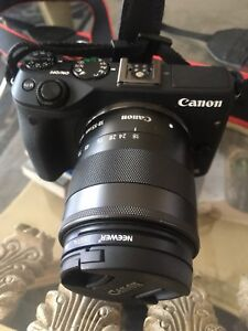 Canon mirrorless eos m3 with 18-55mm lens