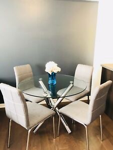 Only $220 for a gorgeous, chic, modern glass table and chairs!!!