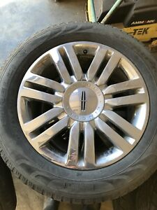 """20"""" Lincoln Navigator rims and tires"""