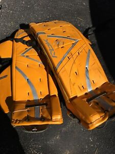 GOALIE GEAR...2 PRS.PADS, STICK AND REG HOCKEY GEAR