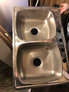 Two stainless sinks