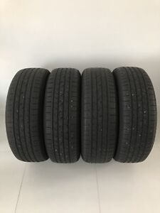 Four 235/65/R18 AllSeason Continental CrossContact LX-Lotsoftred