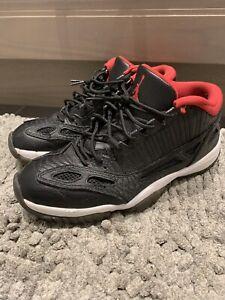 Jordan 11 low black and red size 8.5 mens