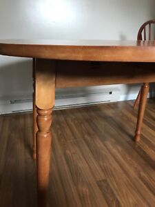 Solid wood heavy table 2 solid wood chairs with new cushions