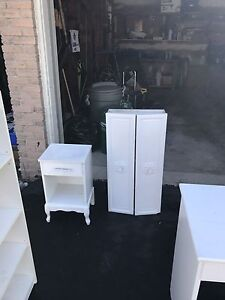 Free shelves, desk and nightstand.