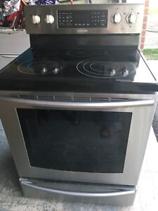 Black and silver Samsung stove